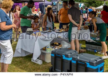 Visitors enjoying the sunshine at Fleet Food Festival 2018, tasting local cheeses - Stock Image