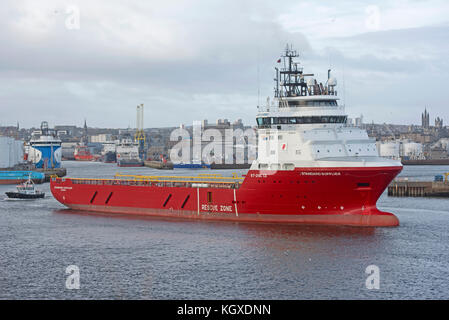 Offshore supply vessel 'Standard Princess' departing from Aberdeen Harbour Docks for the North Sea. - Stock Image
