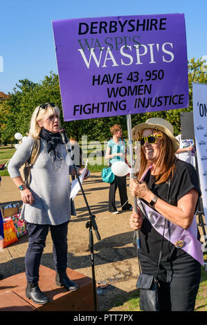 London, UK. 10th October 2018. Groups campaigning for women born in the 1950s to regain the pensions stolen from them under successive governments, including The Waspi Campaign (Women Against State Pension Inequality),  Back to 60, We Paid In, You Pay Out and others, begin a rally in Hyde Park before going to protest at Parliament. Credit: Peter Marshall/Alamy Live News - Stock Image