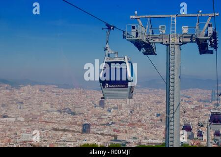 Barcelona, Spain, October 2018. Teleferic de Mont Juic cable car heading for the castle. Bright sunny afternoon. - Stock Image