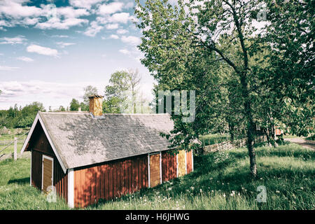 old rural barn and farm house in rural landscape - Stock Image