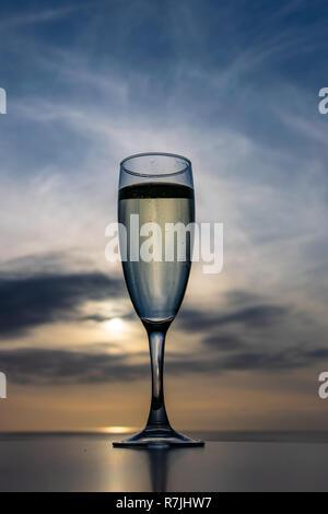 Celebratory drink at sunset - Stock Image