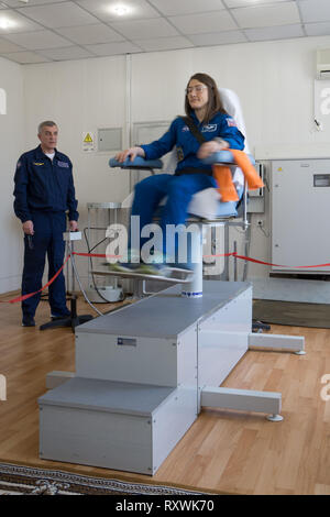 International Space Station Expedition 59 crew member Christina Koch rides the rotating chair testing his vestibular system at the Baikonur Cosmodrome March 7, 2019 in Baikonur, Kazakhstan. Expedition 59 crew: Christina Koch of NASA, Alexey Ovchinin of Roscosmos, and Nick Hague of NASA will launch March 14th onboard the Soyuz MS-12 spacecraft for a six-and-a-half month mission on the International Space Station. - Stock Image