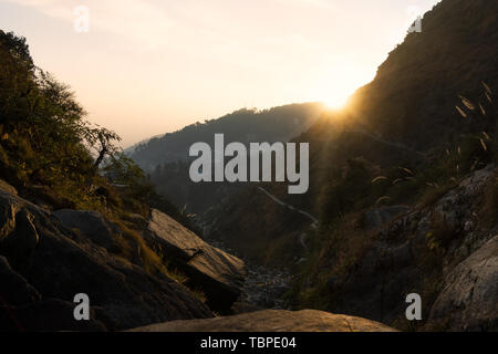 Stunning view of a beautiful sunset behind some mountains in Dharamshala, Himachal Pradesh, India. - Stock Image