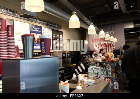Inside view of Costa Coffee counter, cups and customers at Paddington Station in London UK  KATHY DEWITT - Stock Image