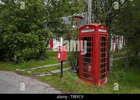 Red telephone box and postbox in a rural setting near Feshiebridge in Cairngorms National Park, Scotland, UK. - Stock Image