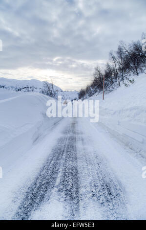 Picture of a road with a lot of snow - Stock Image