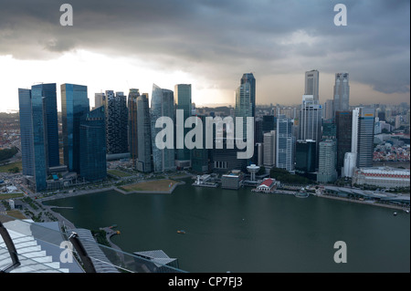 Looking toward the downtown financial district sky scrapers from the Marina Bay Sands hotel observation deck Singapore - Stock Image