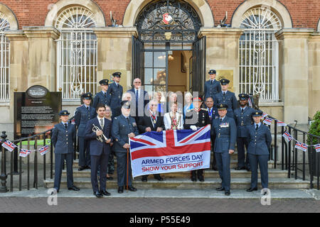 Aylesbury, United Kingdom. 25 June 2018. Earlier today Chairman Netta Glover was joined by County Councillors, Deputy Lieutenants, RAF personnel and other civic dignitaries in Market Square in the presence of Sir Henry Aubrey-Fletcher, HM Lord-Lieutenant of Buckinghamshire and Group Captain James Brayshaw, Station Commander at RAF Halton, to mark Armed Forces Day. The Armed Forces Flag was raised by Army Veteran Lieutenant Colonel John Williams of Bedgrove who served in the Royal Logistics Corps. Credit: Peter Manning/Alamy Live News - Stock Image