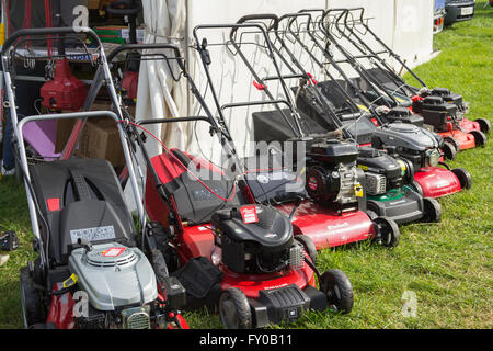 Einhall and Qualcast petrol driven grass mowers on sale at a trade stand at the Lancashire Game and Country Festival - Stock Image