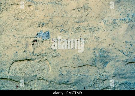 Old painted brick work, duo toned in yellow and blue - Stock Image