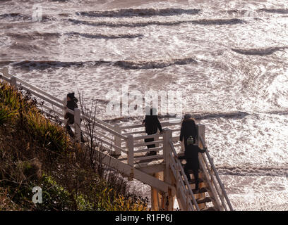 Sidmouth, Devon, 12th Nov 18 Stormy seas at Sidmouth - walkers climb the steps at Jacob's Ladder to get a better view. Photo Central/Alamy Live News. - Stock Image