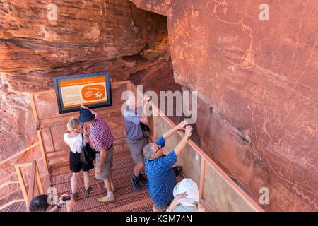 Petroglyphs at Atlatl Rock, The Valley of Fire Nevada State Park. A popular bus tour from las Vegas. - Stock Image