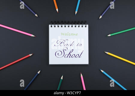 Open notebook with blank pages and pencil on white background. Back to school concept - Stock Image