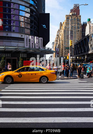 The busy streets of Times Square in Midtown Manhattan, New York, including the famous yellow cabs - Stock Image