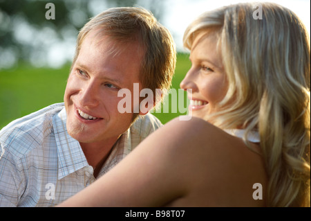 Couple lying in park - Stock Image