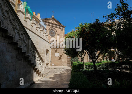 La Lonja de la Seda building courtyard, with front facade of Iglesia del Sagrado Corazón de Jesús de la Compañía in the backlground, Valencia, Spain - Stock Image