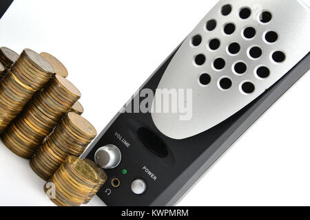 Speakers with coins isolated on white background - Stock Image