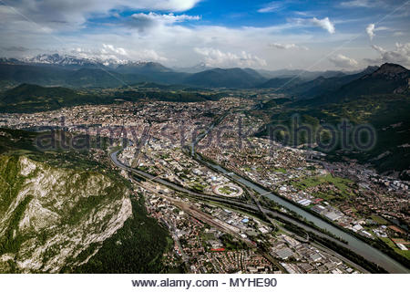Aerial view of Grenoble (France), the Isere and Drac rivers, and the 3 surrounding mountain ranges (Chartreuse, Vercors, Belledonne) - Stock Image