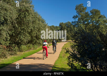 Sierra Norte Natural Park - Cyclists in the Sierra Greenway. San Nicolas del Puerto. Seville province. Region of Andalusia. Spain. Europe - Stock Image