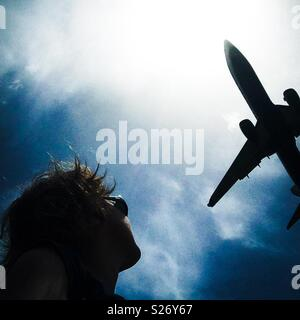 Comercial jet airplane landing in Barcelba airport - Stock Image