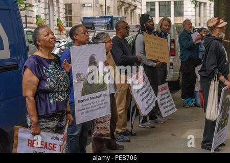 London, UK. 13th August 2018. Protesters outside the offices of Schroders. Three days before the 6th anniversary of the massacre when 34 striking miners were shot dead by South African police at Lonmin's Marikana platinum mine, a tour of the City of London visited investors, insurers and shareholders profiting from the violence against people and nature in Marikana and heard about the colonial roots of the huge wealth of the City. Credit: Peter Marshall/Alamy Live News - Stock Image