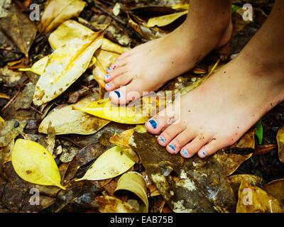 Barefoot on fallen leaves. - Stock Image