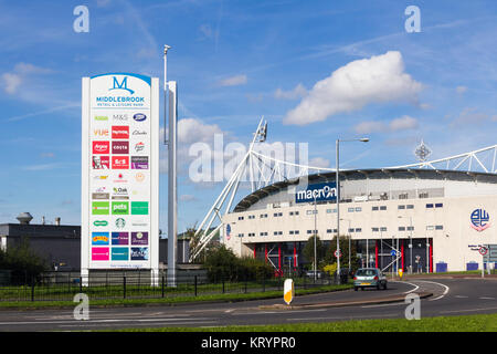 Signage near the entrance to Middlebrook Retail Park, Horwich, adjacent to the Macron Stadium, home of Bolton Wanderers - Stock Image