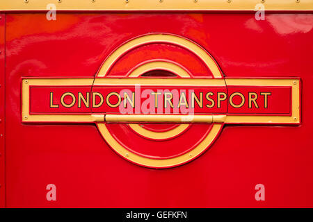 WEYBRIDGE, SURREY, UK - AUGUST 9, 2015: A vintage Red London Transport badge on a vintage London bus. - Stock Image