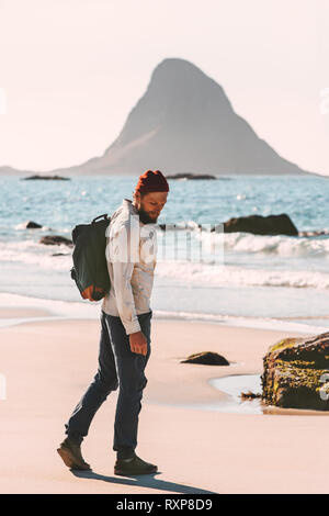 Man walking at ocean beach solo traveling lifestyle adventure summer active vacations outdoor - Stock Image