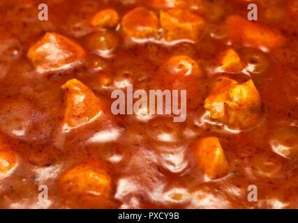Tikka Masala, curry sauce, and chicken close up macro - Stock Image
