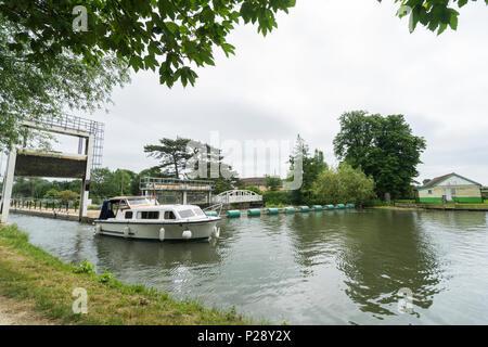 river cruiser leaving Baits Bite Lock for Cambridge - Stock Image