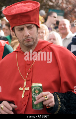 Cardinal holding a can of Carlsberg larger during the42nd World Conker Championships at Ashton Northamptonshire - Stock Image