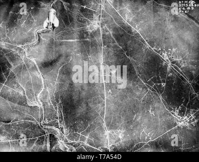 A remarkable black and white aerial British photograph taken on 6th June 1916 during  World War One, clearly showing two bombs being dropped from aeroplanes on to targets over Northern France. - Stock Image