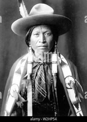Edward S. Curtis Native American Indians - Jicarilla Apache Indian wearing Cowboy hat ca. 1905 - Stock Image