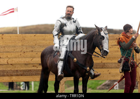 A mounted Knight in full Armour demonstrating  horse riding skills, during an English Heritage Jousting Tournament at Dover Castle,  August 2018 - Stock Image
