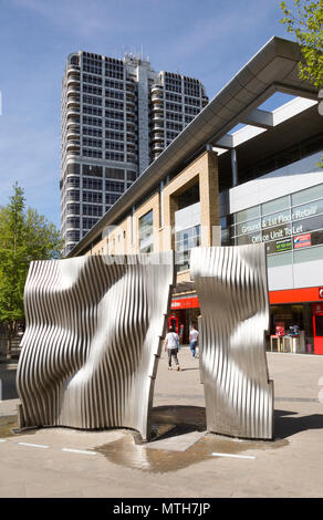 Modern art fountain and The David Murray John Building, the Brunel Tower, central business district of Swindon, Wiltshire, England, UK - Stock Image