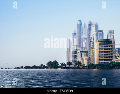 Digital composite of flooded beach at Jumeirah beach in Dubai Marina, UAE - global warming rising sea levels environmental damage concept - Stock Image