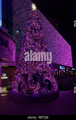 Orchard Road Christmas lights and tree in Singapore, with a Disney theme, pink and cartoon characters - Stock Image