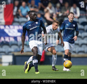 Starks Park, Kirkcaldy, UK. 13th July, 2019. Scottish League Cup football, Raith Rovers versus Dundee; Fernandy Mendy of Raith Rovers challenged by Andrew Nelson of Dundee Credit: Action Plus Sports/Alamy Live News - Stock Image