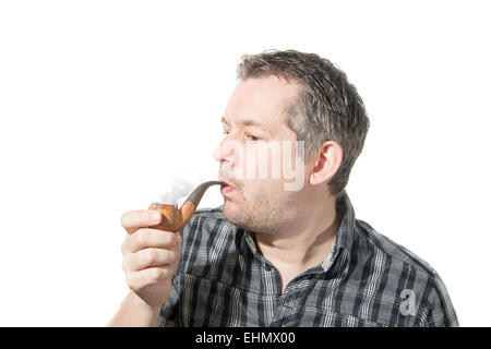 Picture of a man that is smoking on a pipe - Stock Image