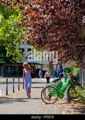 Bike sharing cycling rack hub dock during summer in Piacenza, Italy - Stock Image