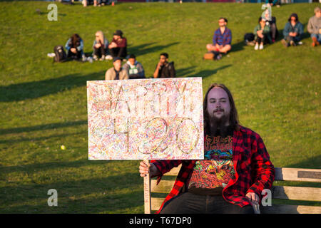 VANCOUVER, BC, CANADA - APR 20, 2019: A man holds a pro marijuana sign at the 420 festival in Vancouver. - Stock Image