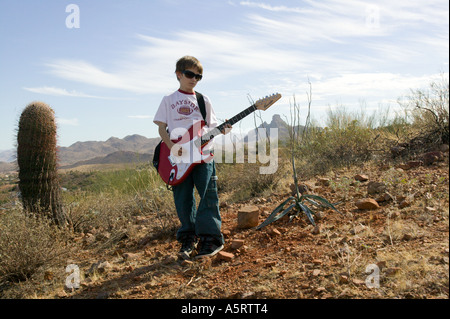 Young Boy Playing Electric Guitar - Stock Image