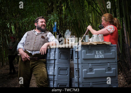 Actors Rory Wilton and Bec Applebee performing in a scene from the theatre production called Operation Neptune in the grounds of Trebah Garden in Corn - Stock Image
