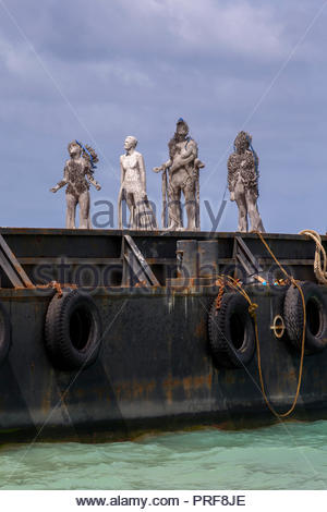 Coral covered statues of the Coralarium on wharf in Maldives - Stock Image