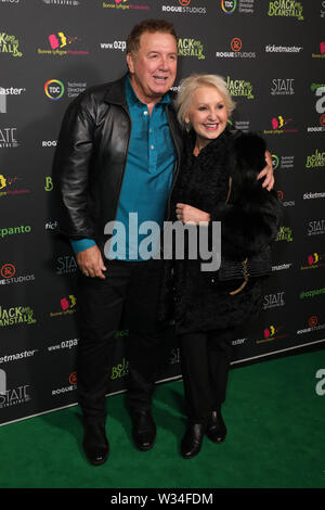 Sydney, Australia. 12th July 2019. Jack and the Beanstalk Giant 3D musical spectacular red carpet at the State Theatre. Pictured: Peter Everett and Prue MacSween. Credit: Richard Milnes/Alamy Live News - Stock Image