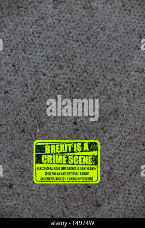 Stickers on the pavement stating that 'Brexit is a Crime Scene' following the March 2019 anti Brexit protest - Stock Image