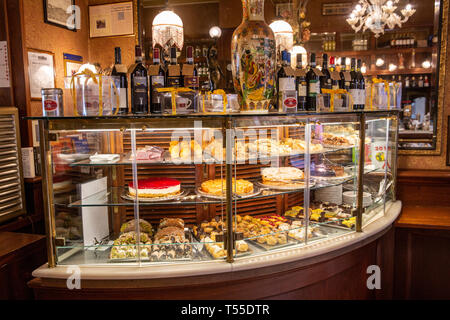 Traditional italian food counter in a restaurant cafe in Montepulciano displaying cakes and pastries and desserts,Tuscany,Italy - Stock Image
