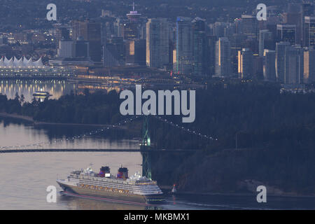 Morning city view of downtown Vancouver from Cypress Mountain High View Lookout with Lions Gate Bridge and ship passing beneath. - Stock Image